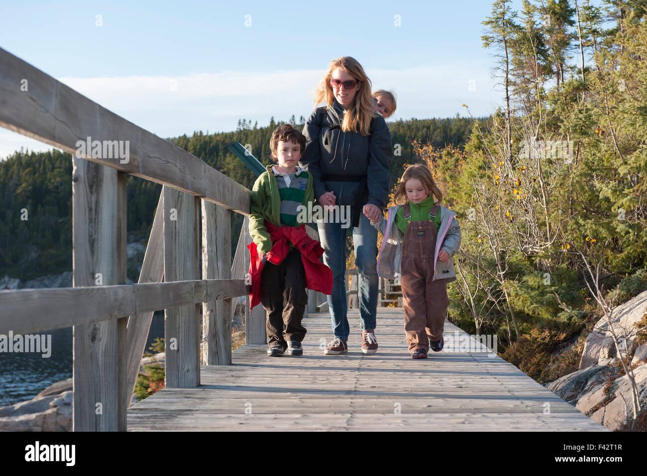 Mother and three children enjoying nature walk - Stock Image