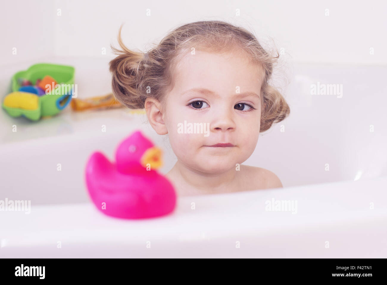 Little girl taking a bath - Stock Image
