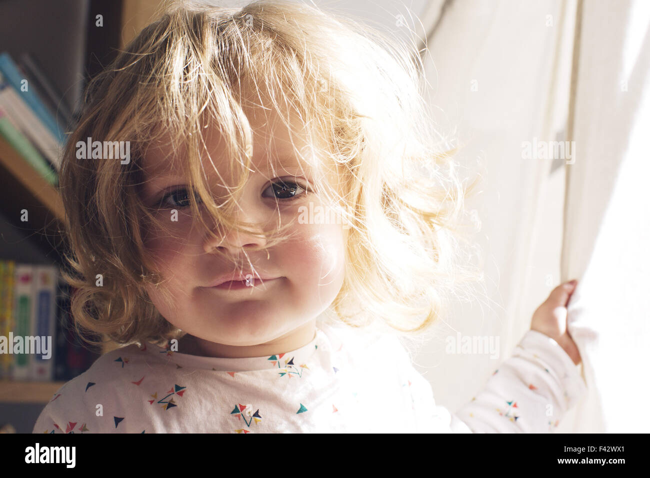 Little girl with messy hair, portrait - Stock Image