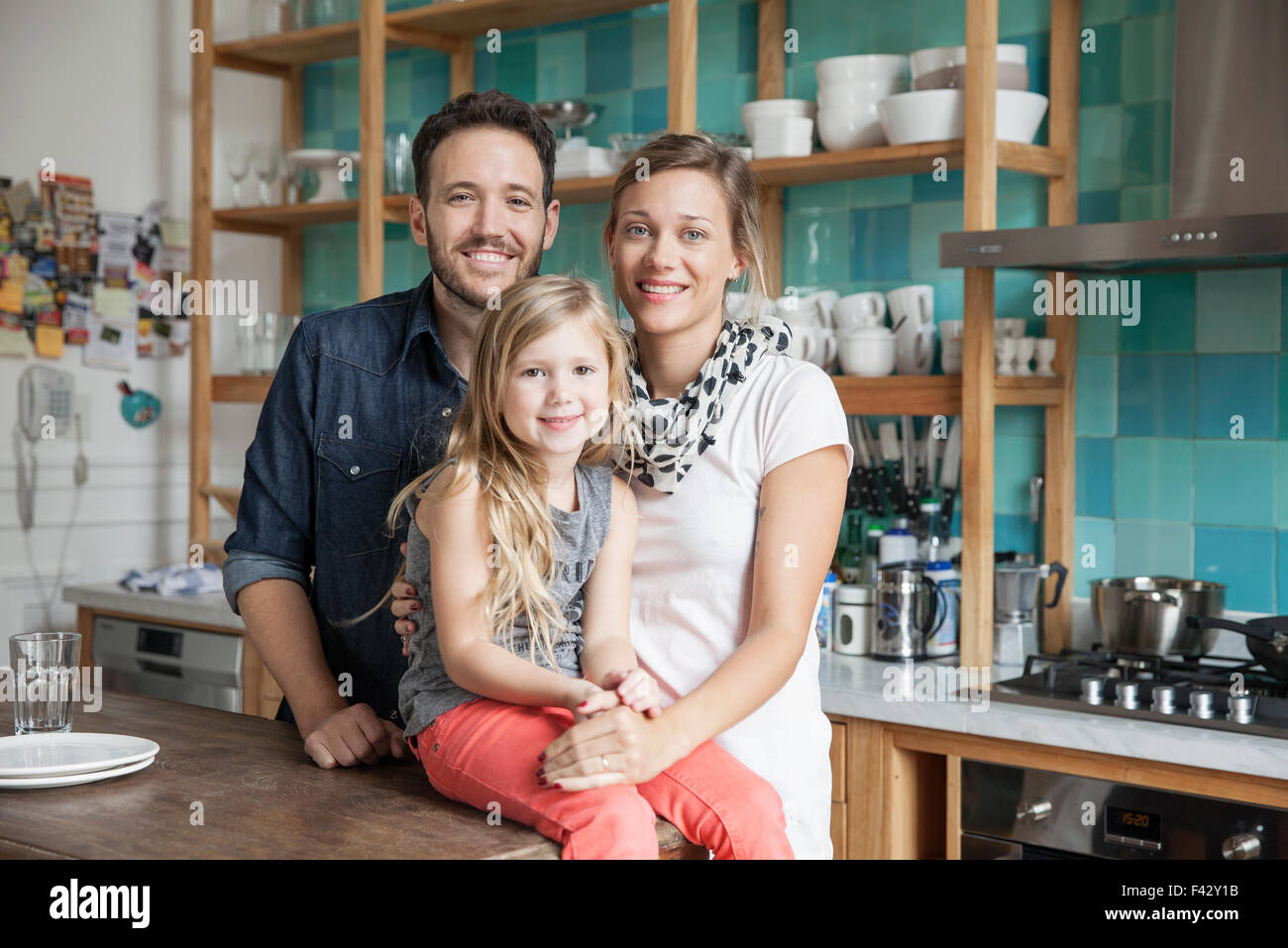 Family at home together in kitchen, portrait Stock Photo