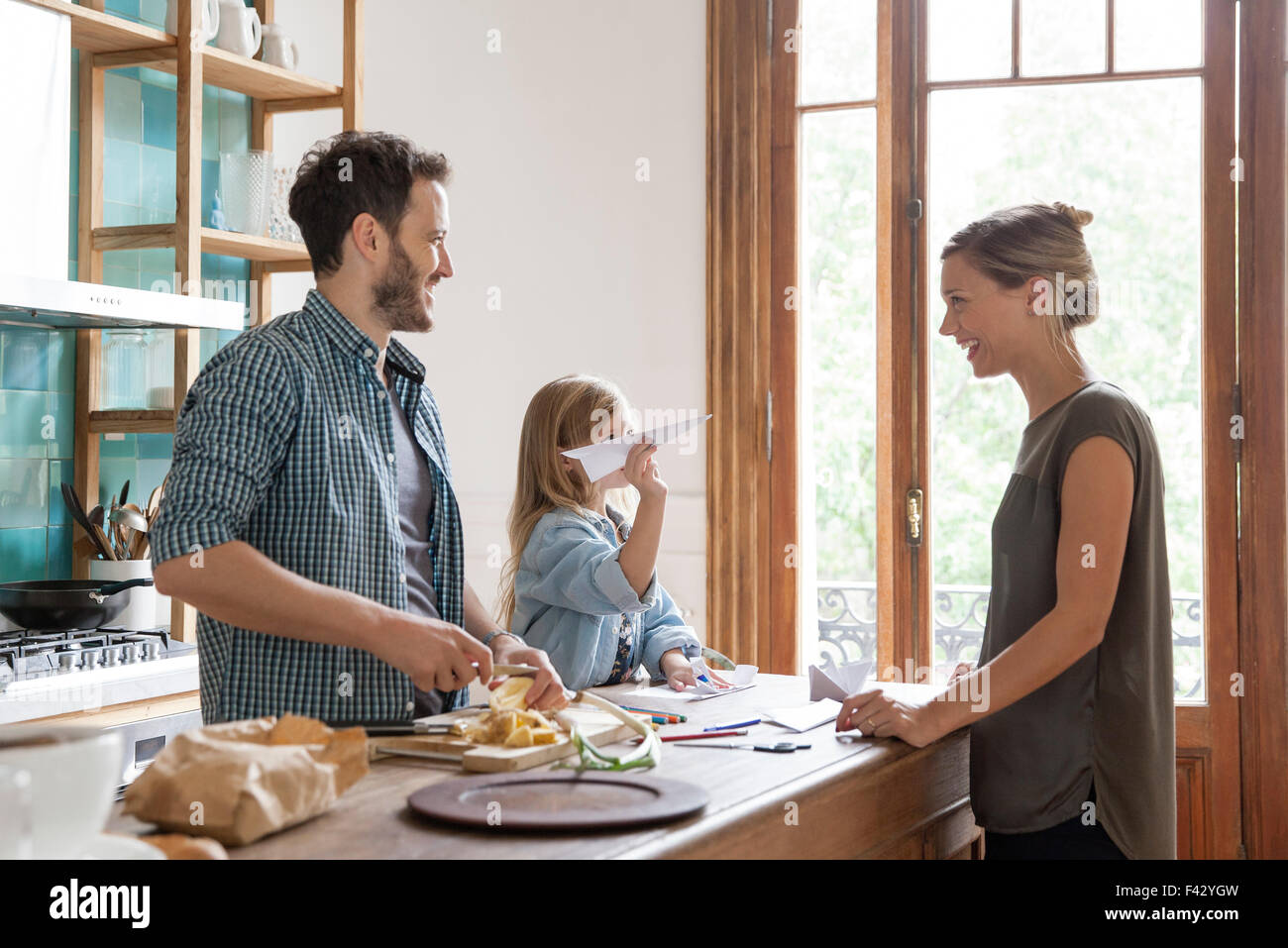 Family spending time together in kitchen - Stock Image