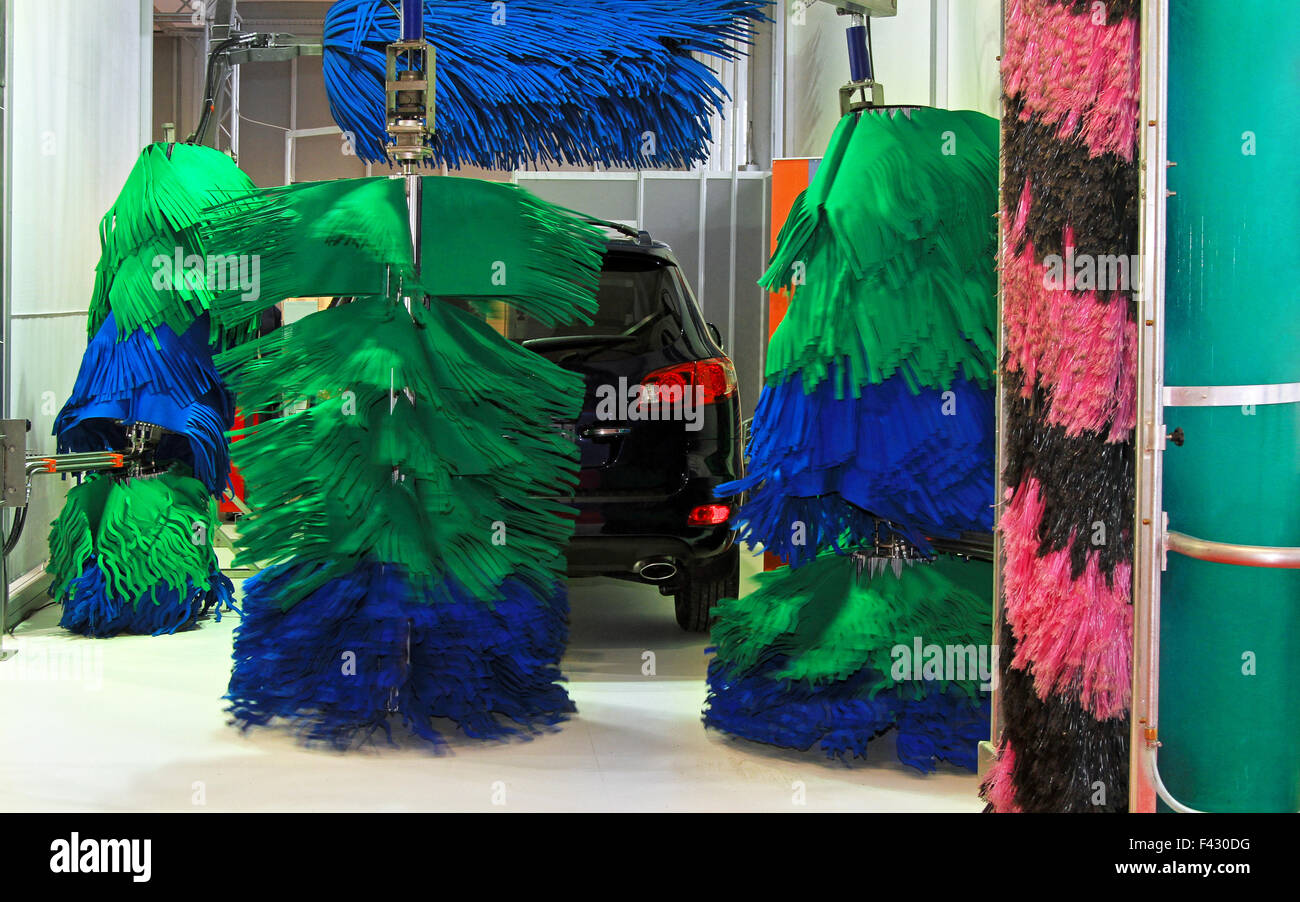 Car wash service with mop style brushes - Stock Image