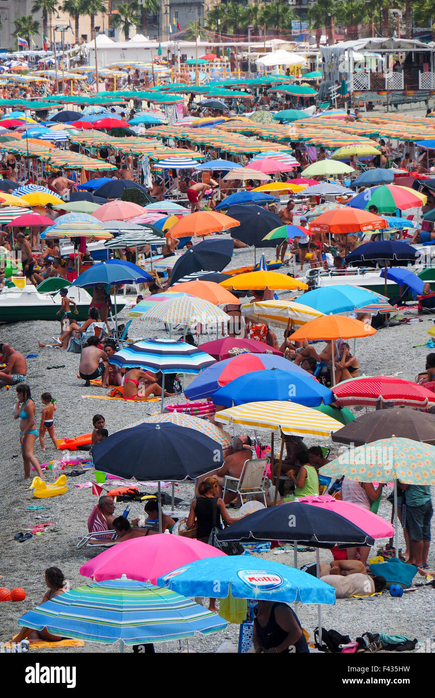 Beach goers at the popular beach of Scilla, Calabria Italy. - Stock Image
