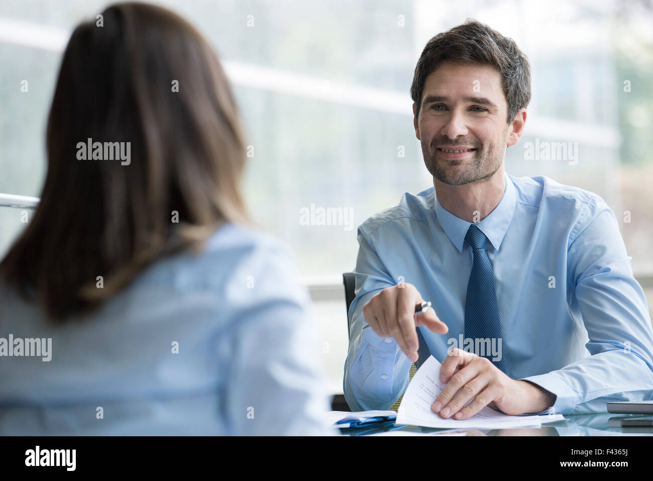 Insurance agent meeting with prospective customer - Stock Image