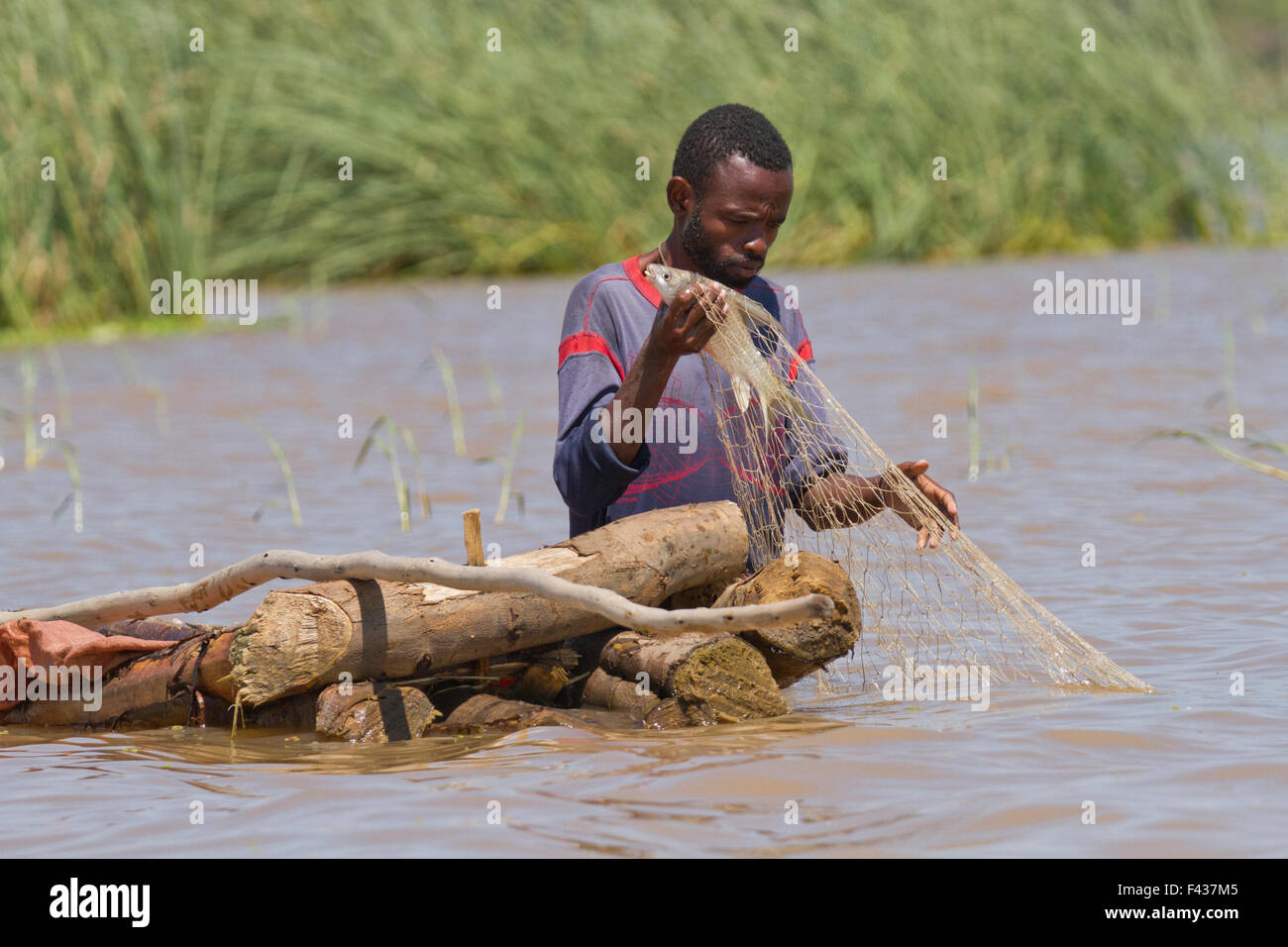 Africa, Ethiopia, man fishing in the river - Stock Image