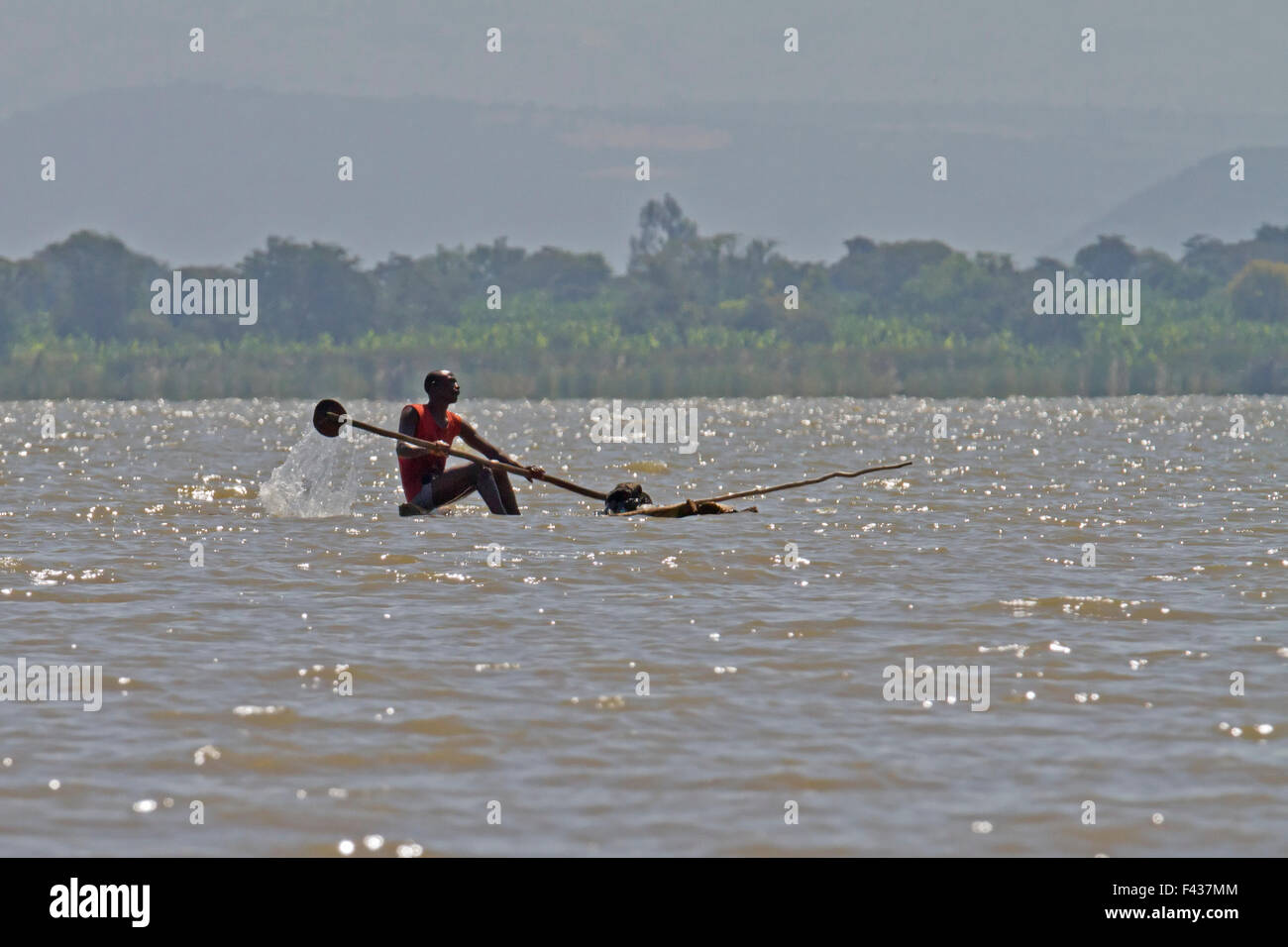 Africa, Ethiopia, Blue Nile river man in a dugout canoe - Stock Image