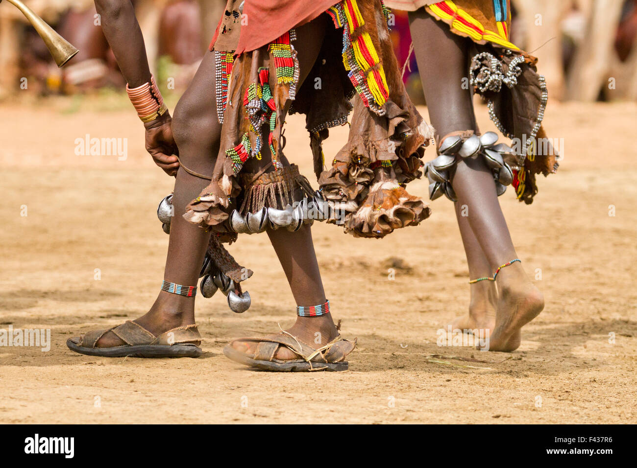 feet of Hamer women with bells at a tribal dance Omo Valley, Ethiopia - Stock Image
