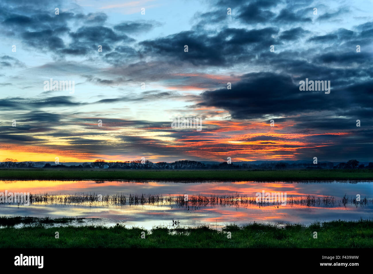 Spectacle clouds Sunset Reflection - Stock Image