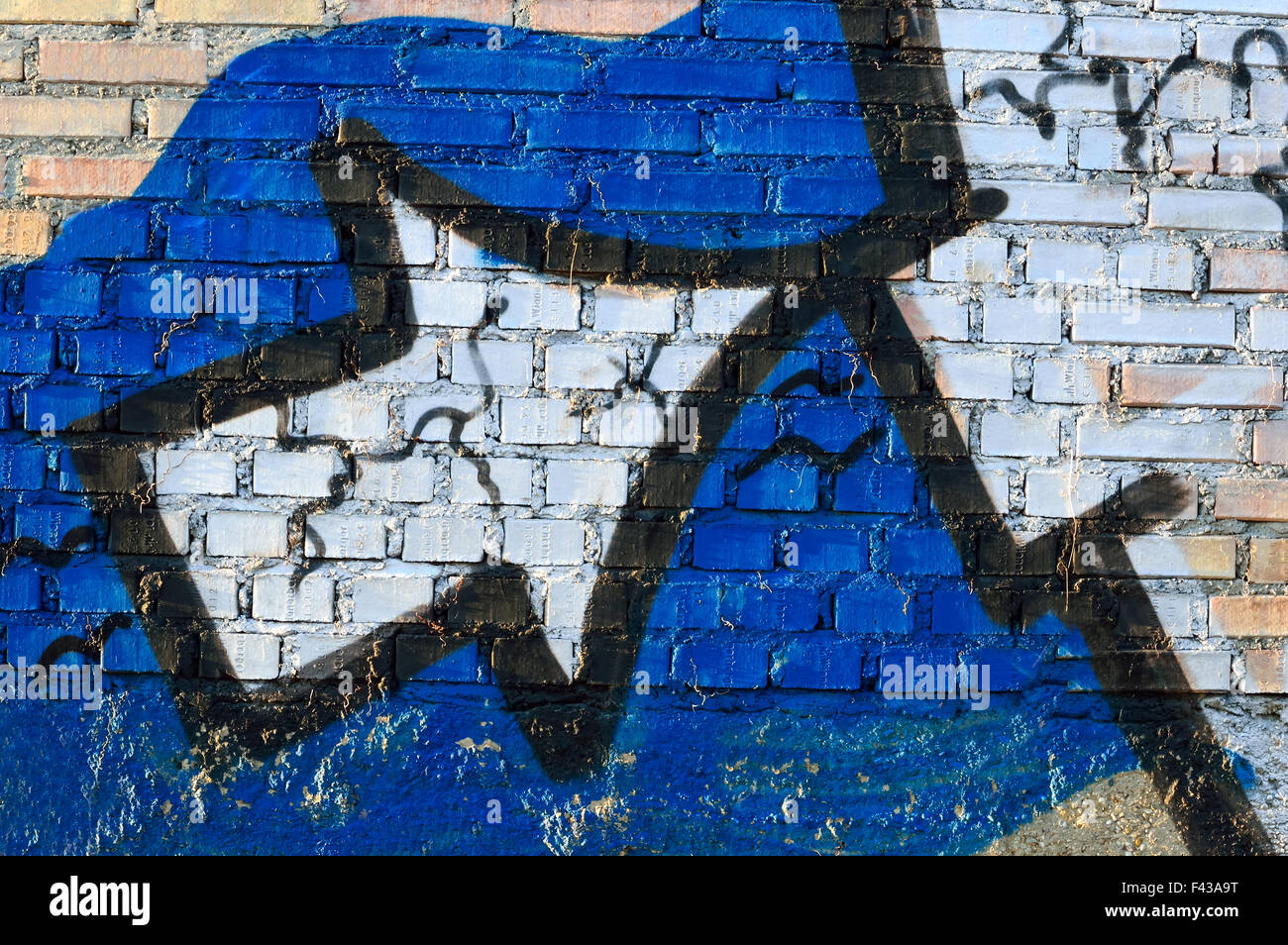 Arrow on the wall - Stock Image
