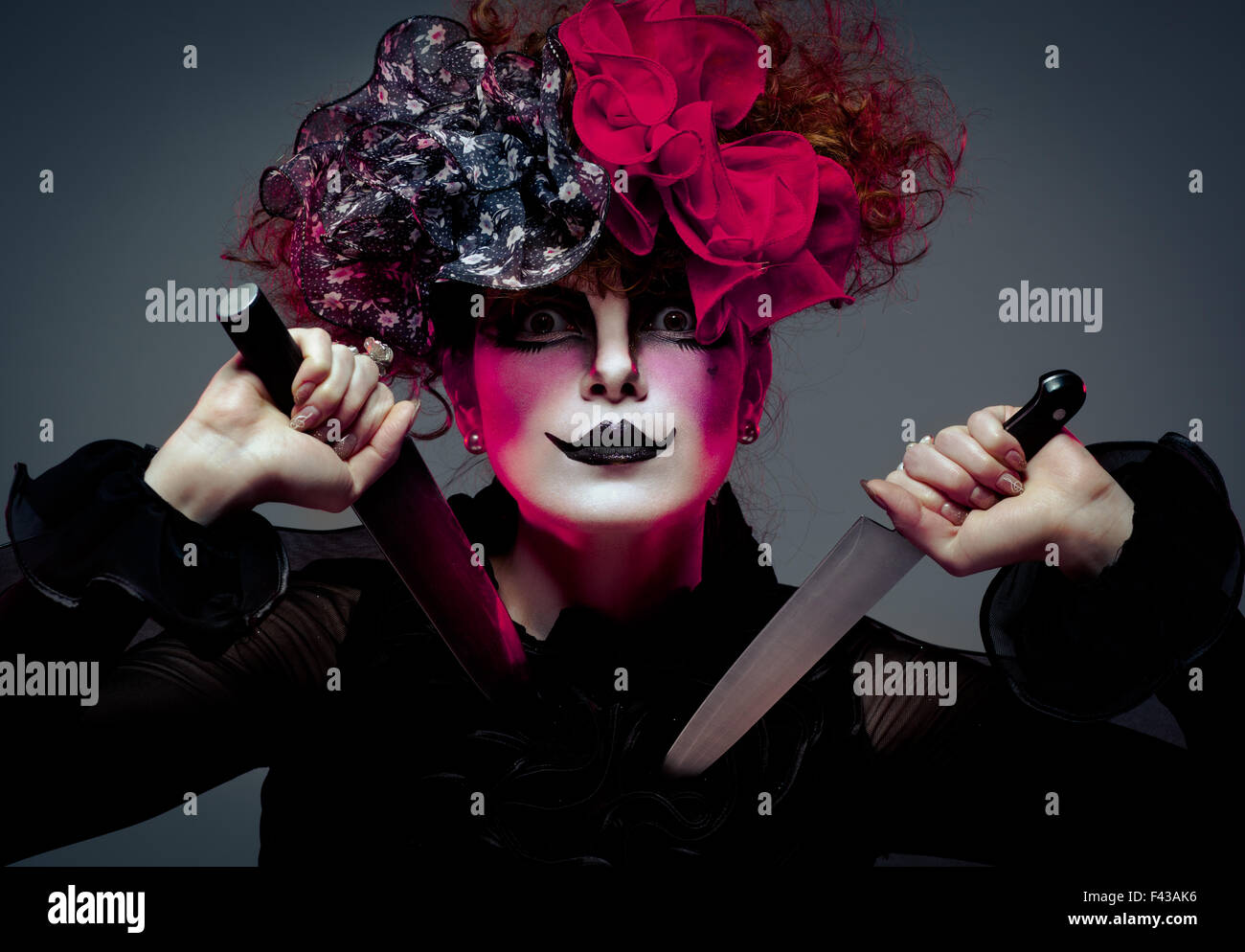 woman mime with knife - Stock Image