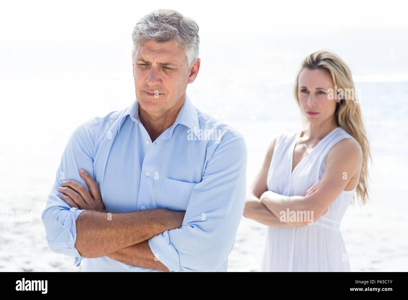 Upset couple having a disagreement - Stock Image