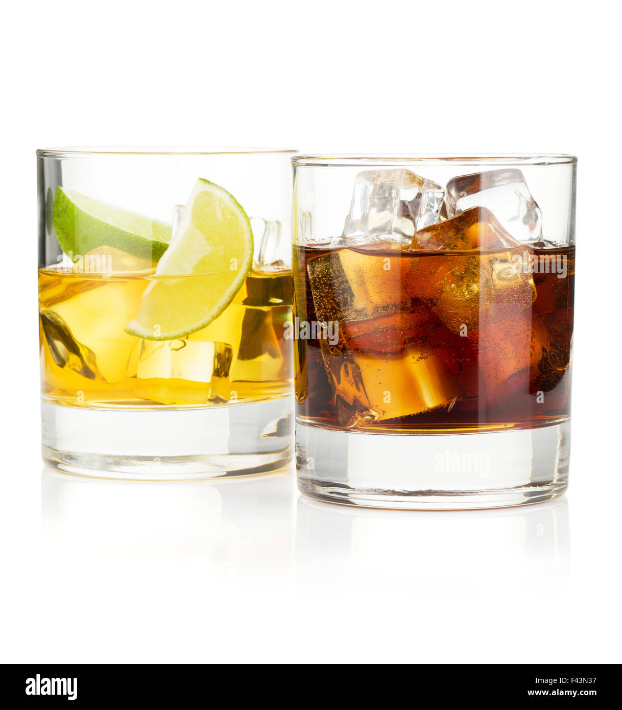 Whiskey and cola cocktails. Isolated on white background - Stock Image