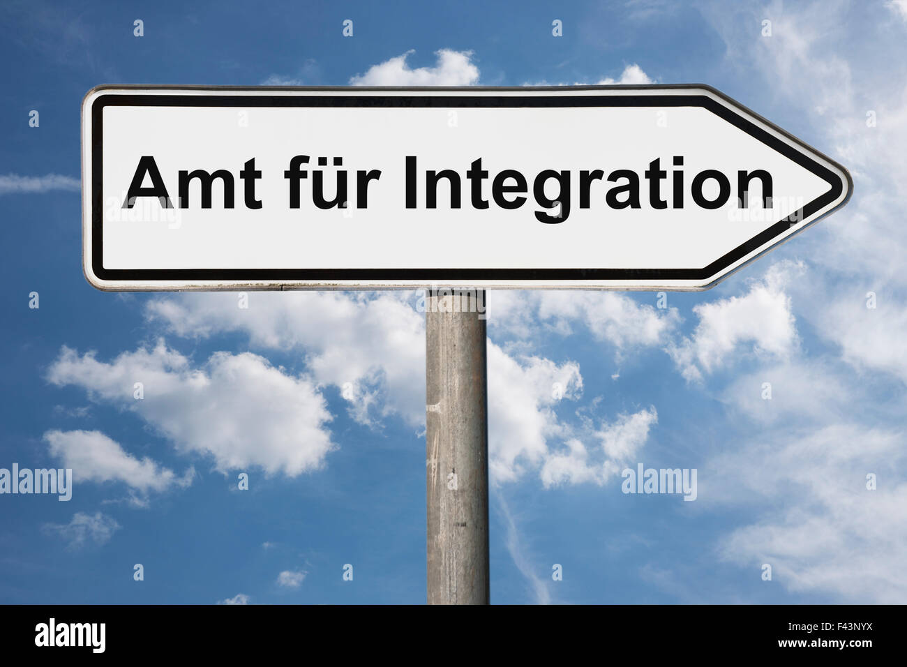 Detail photo of a signpost with the German title Amt fuer Integration (Integration Office) - Stock Image