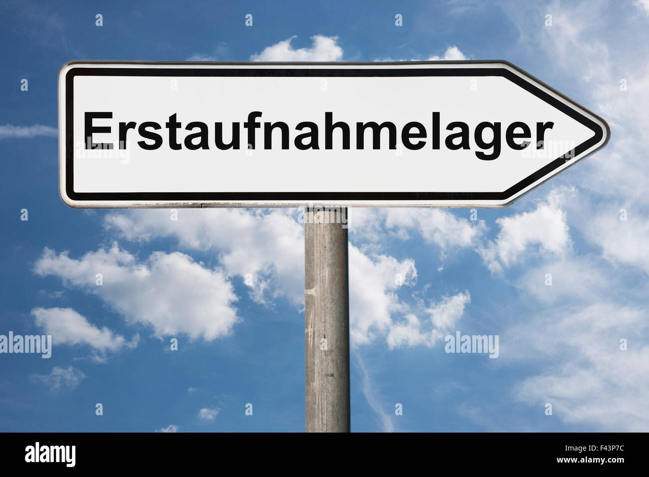 Detail photo of a signpost with the German title Erstaufnahmelager (Initial reception center) - Stock Image