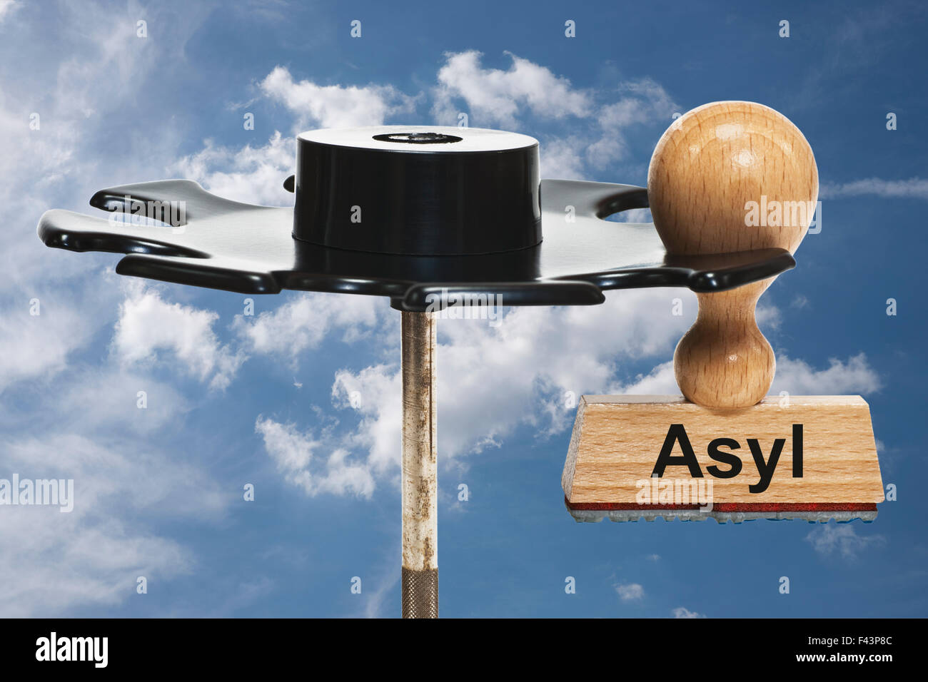 a stamp with the German inscription Asyl (Asylum) hangs in a stamp rack - Stock Image