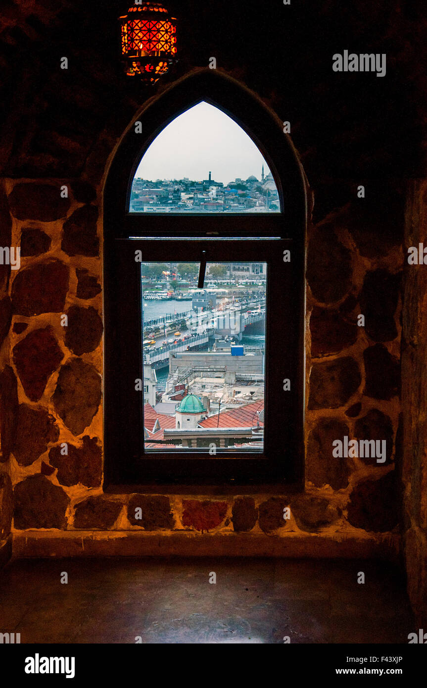 Window in view of golden horn Galata Tower in Istanbul. - Stock Image