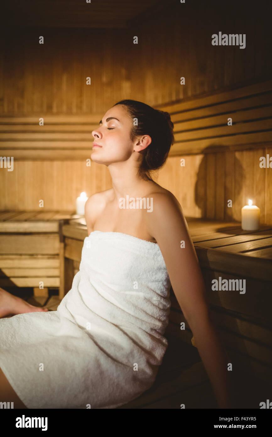 Happy woman enjoying the sauna - Stock Image