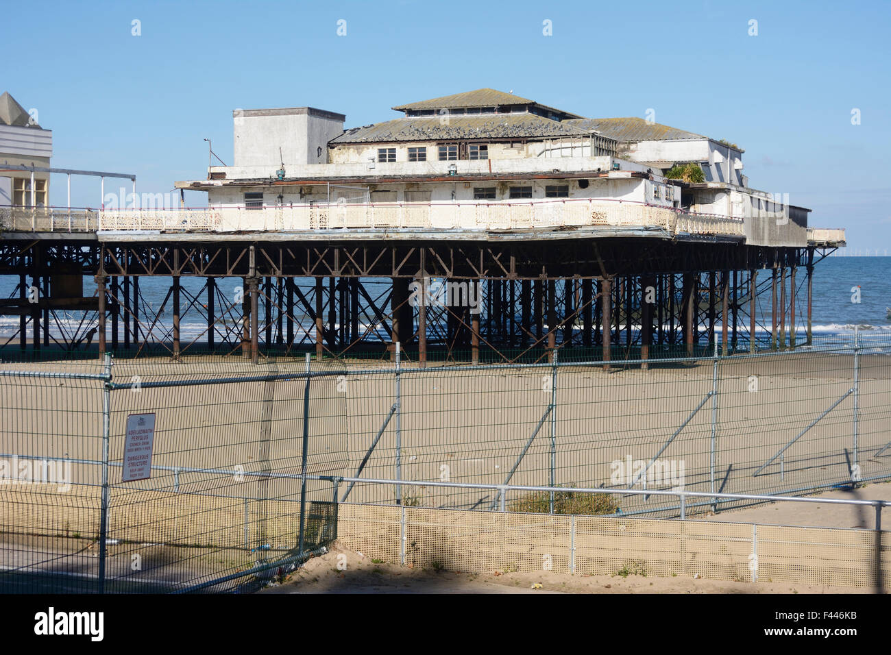 Colwyn Bay pier in a state of decay and disrepair. - Stock Image