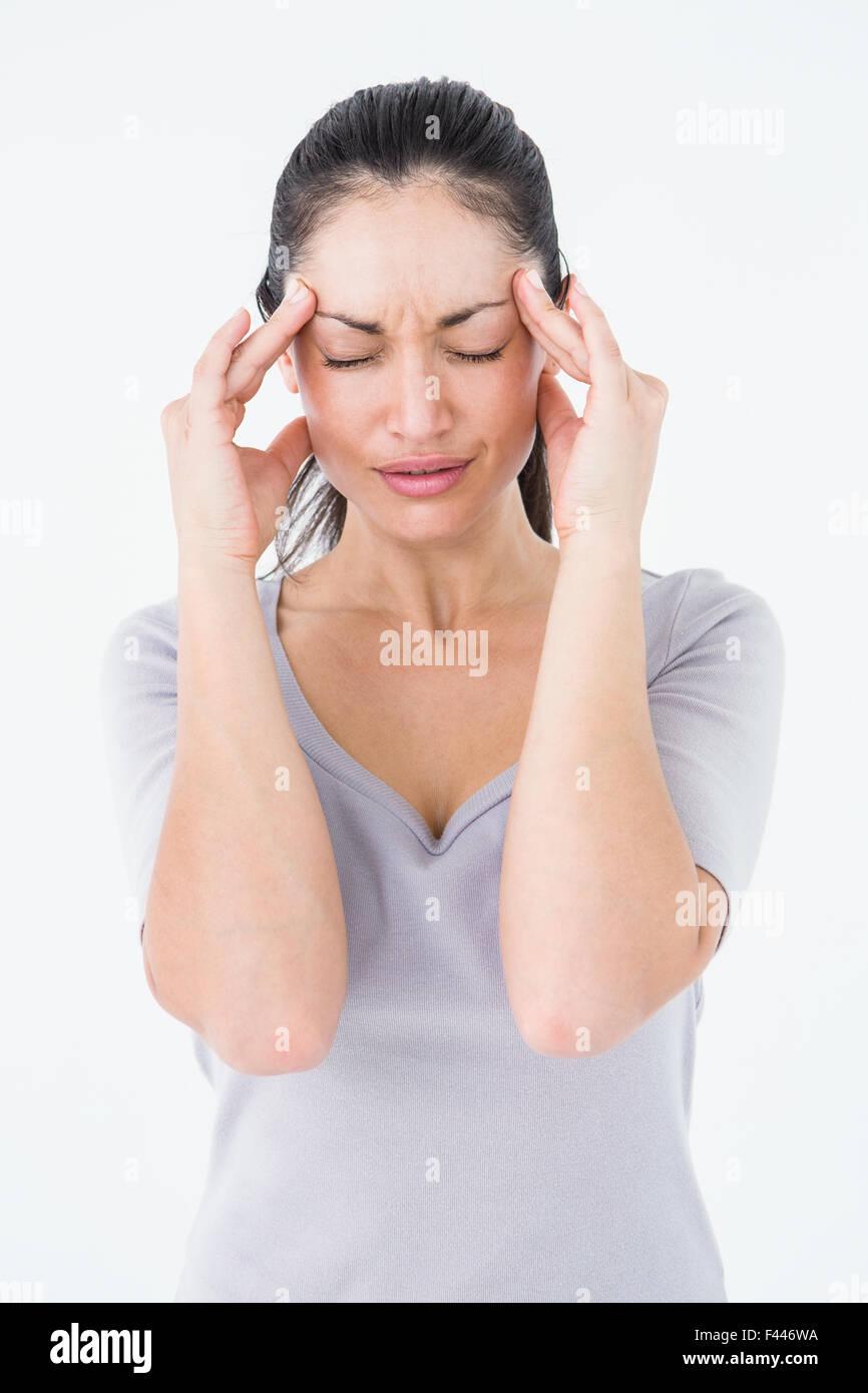 Brunette suffering from migraine - Stock Image