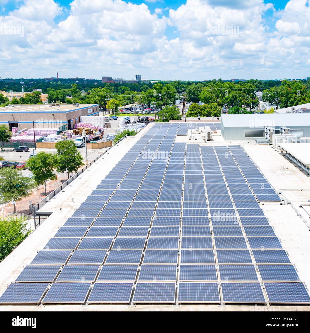 Solar Panels On Urban Rooftop - Stock Image