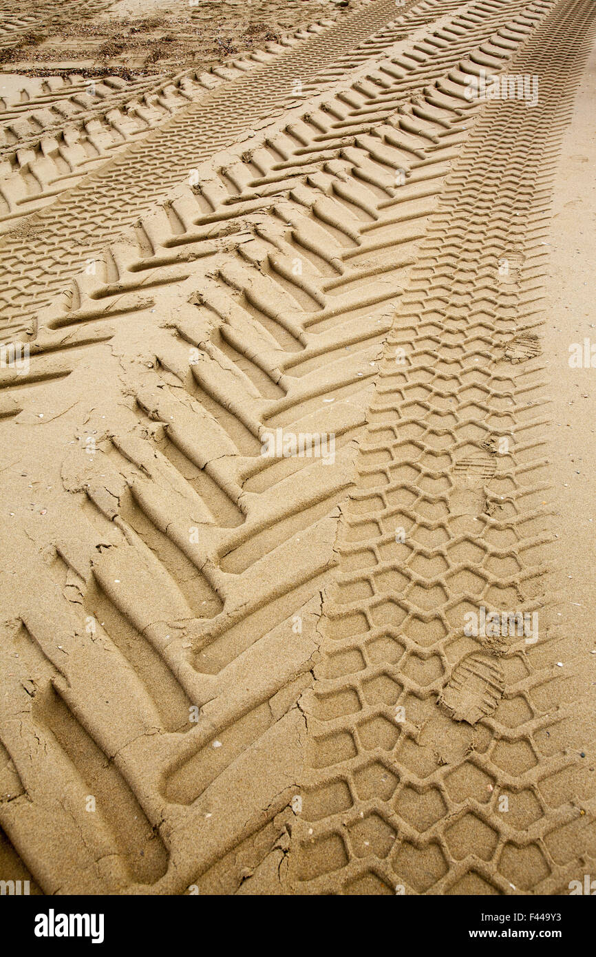 Heavy duty tire tracks on the beach at the North Sea, Hague, Netherlands. - Stock Image