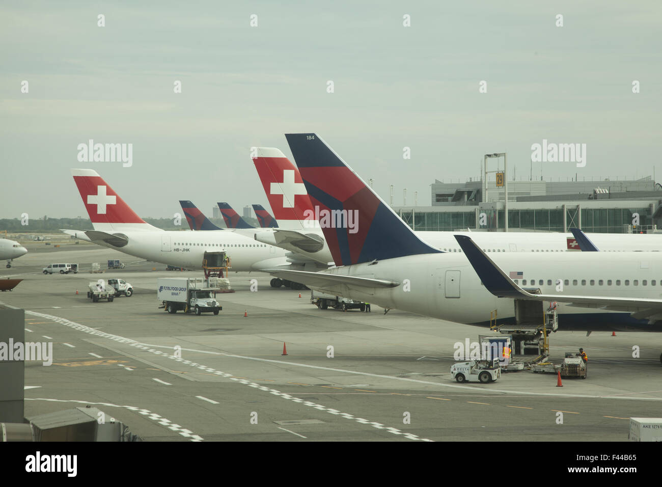 Swiss International Airlines airplanes on the tarmac at JFK International Airport in New York City. - Stock Image
