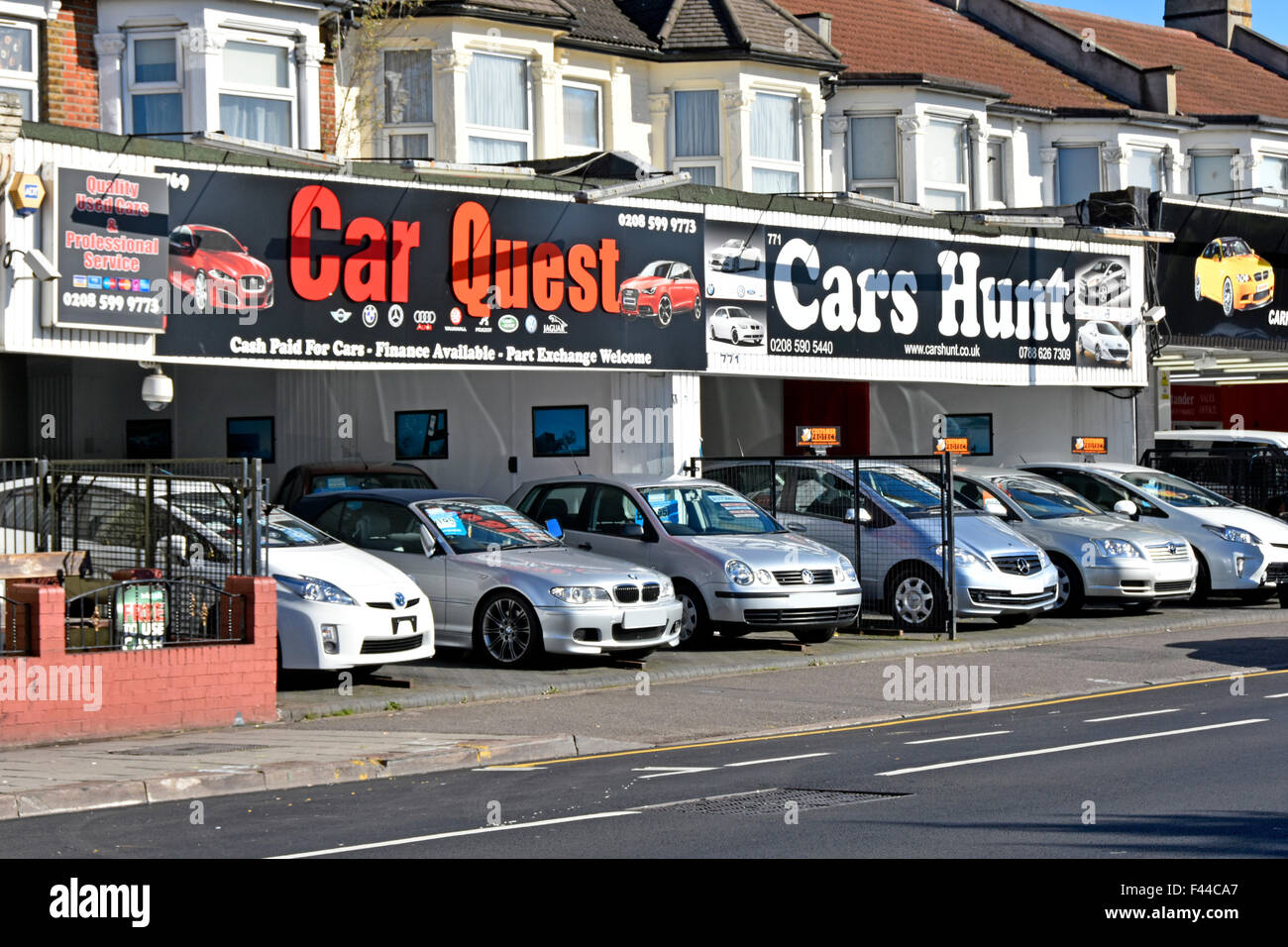 Second hand used cars for sale along ground floor house frontages ...