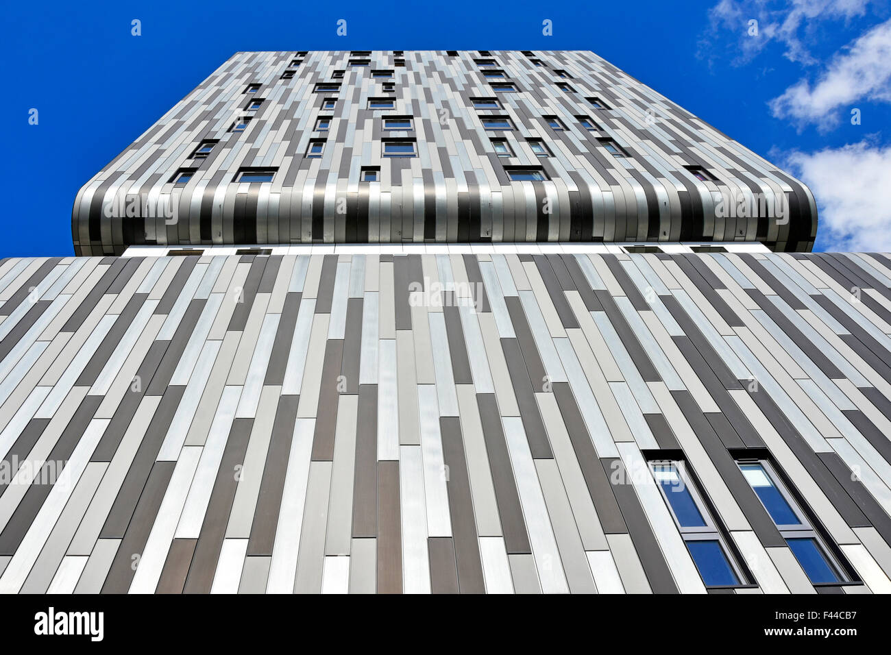 Apartment building block providing new homes in Woolwich South London England UK shades of grey used in striped - Stock Image