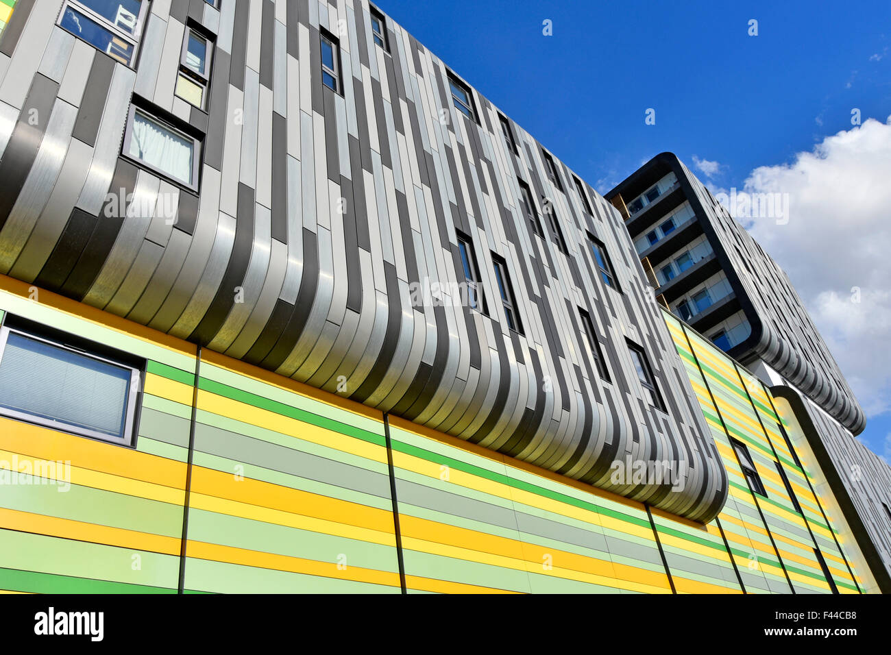 Woolwich Central South London England UK shades of grey & colours used in striped cladding exterior of modern - Stock Image