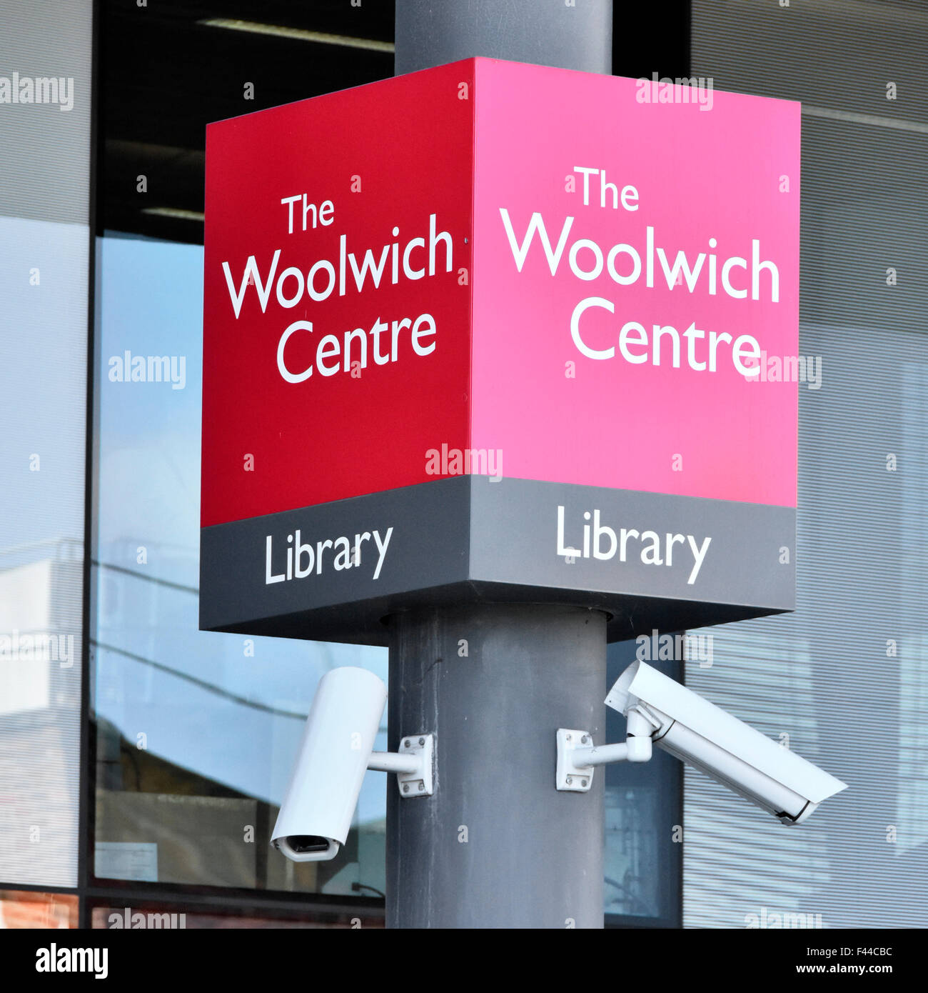 South London England UK sign outside the Woolwich Centre entrance and public library complete with CCTV cameras Stock Photo