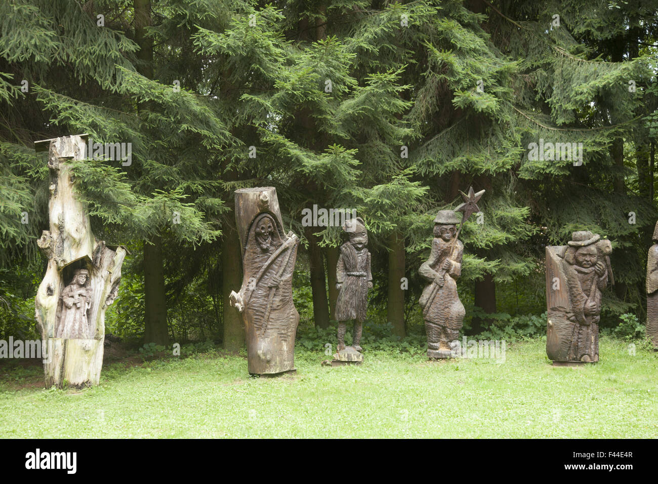 Folk art Wooden carvings from single logs on display at a park in Zielona Gora, Poland. - Stock Image