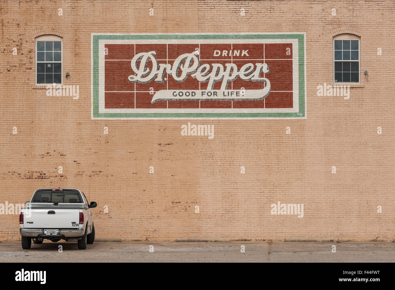 Drink Dr Pepper vintage wall mural on painted brick building in