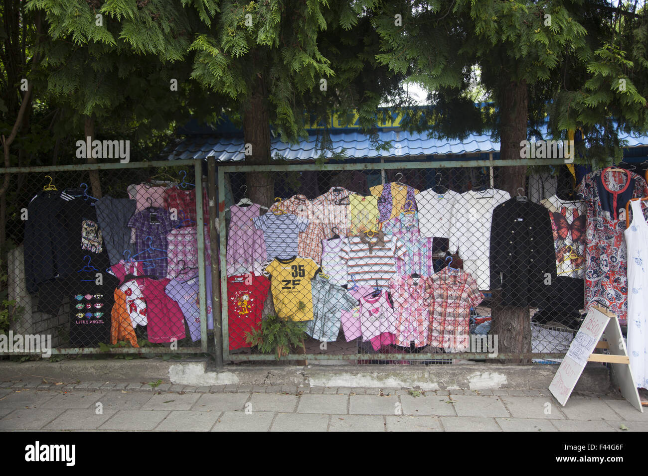 Used clothing vendor on the street in Zielona Gora, Poland. - Stock Image