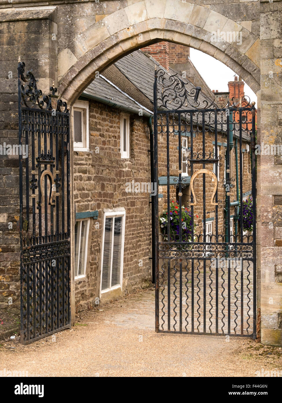 Stone arch and wrought iron gates at the entrance to