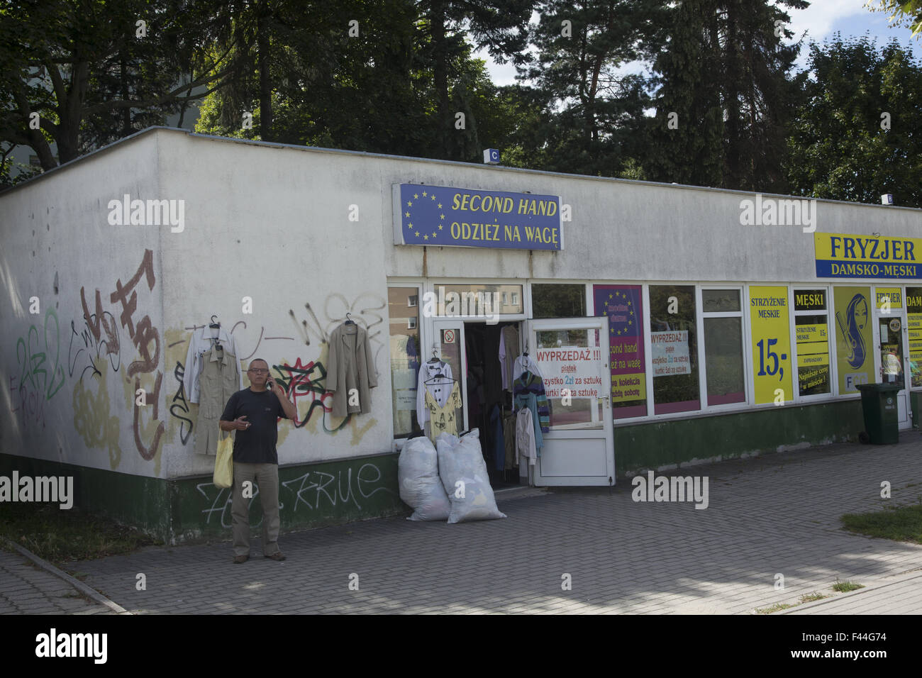 Second hand clothing shop in Zielona Gora, Poland. - Stock Image