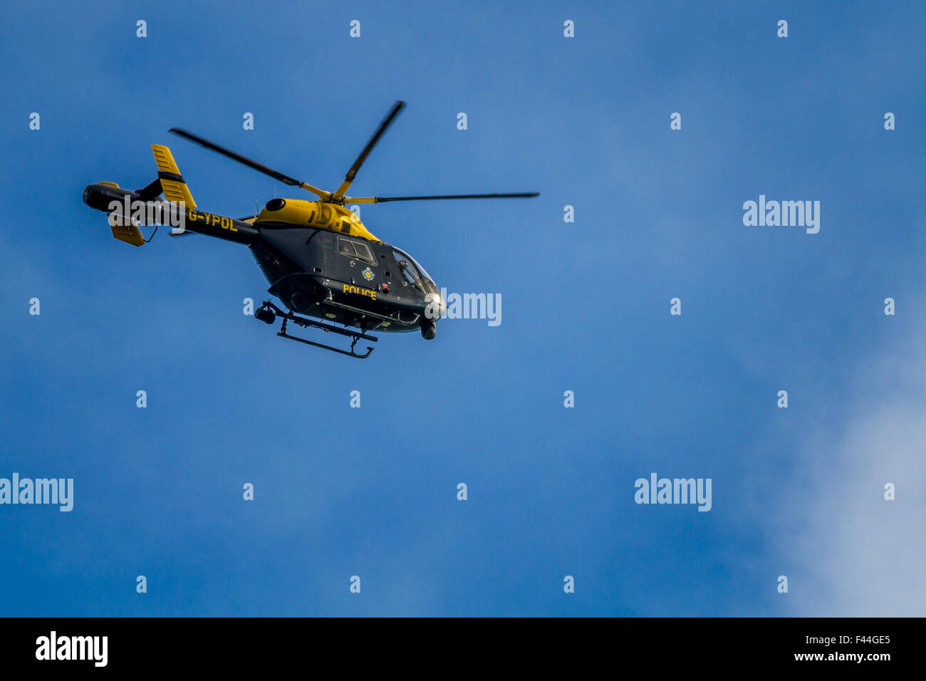 Police search helicopter assisting with an 'ongoing incident' at Burley Woodhead - Stock Image