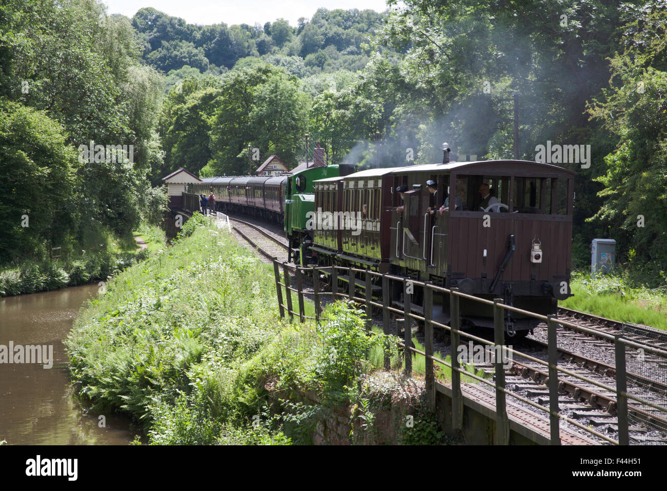 Vintage train hauled by a steam locomotive at Consall Station on The Churnet Valley Railway Staffordshire England - Stock Image