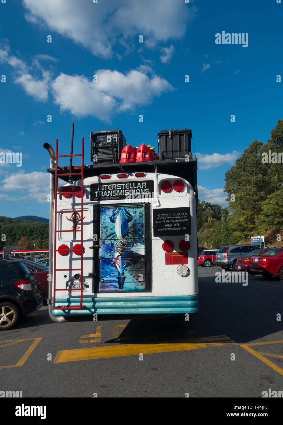 cult bus in truck stop - Stock Image