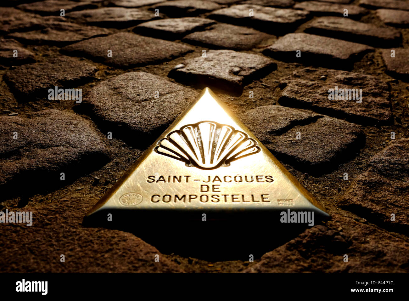 Bronze plaque that marks the beginning of the French route to Santiago de Compostela in Saint-Jean-Pied-de-Port, - Stock Image