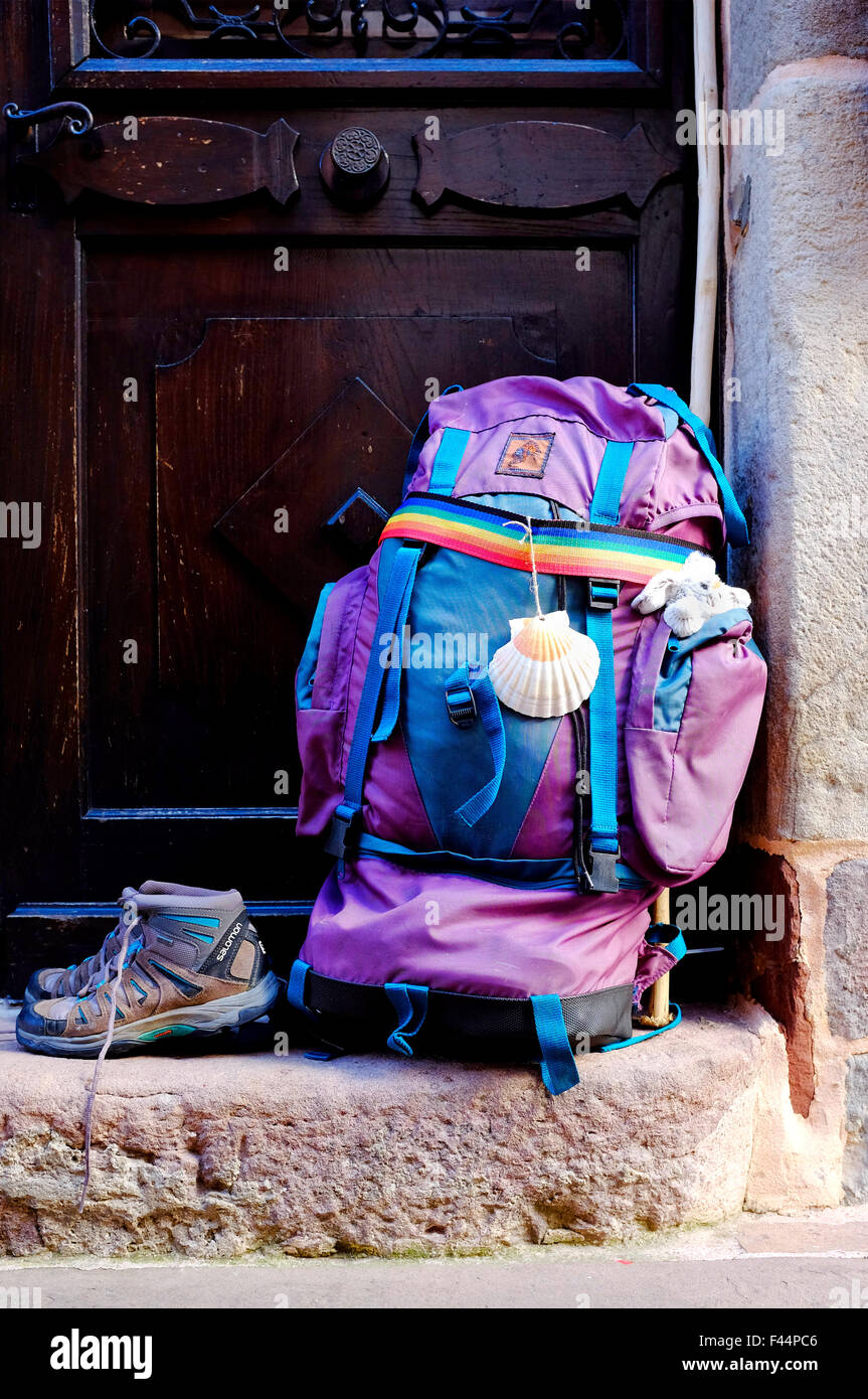 Pilgrim's backpack and shoes on the Way of Saint James (Camino de Santiago). - Stock Image