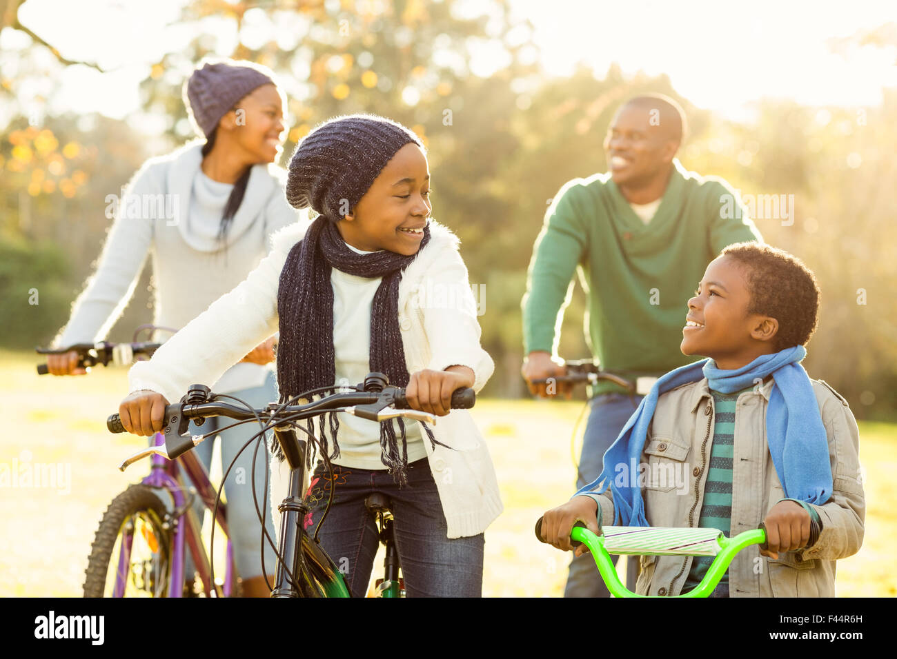 Young smiling family doing a bike ride - Stock Image