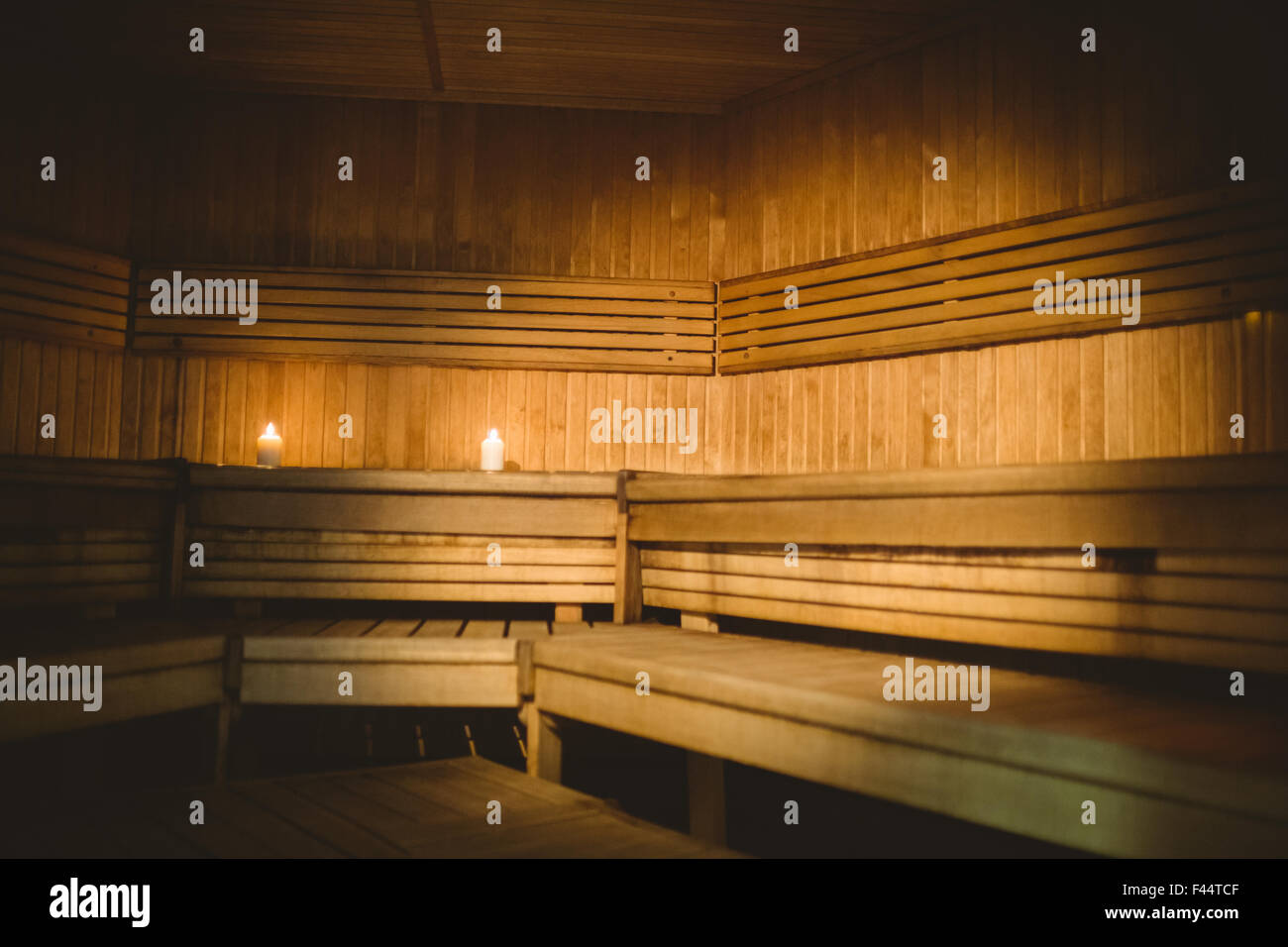 A sauna room with lit candles - Stock Image
