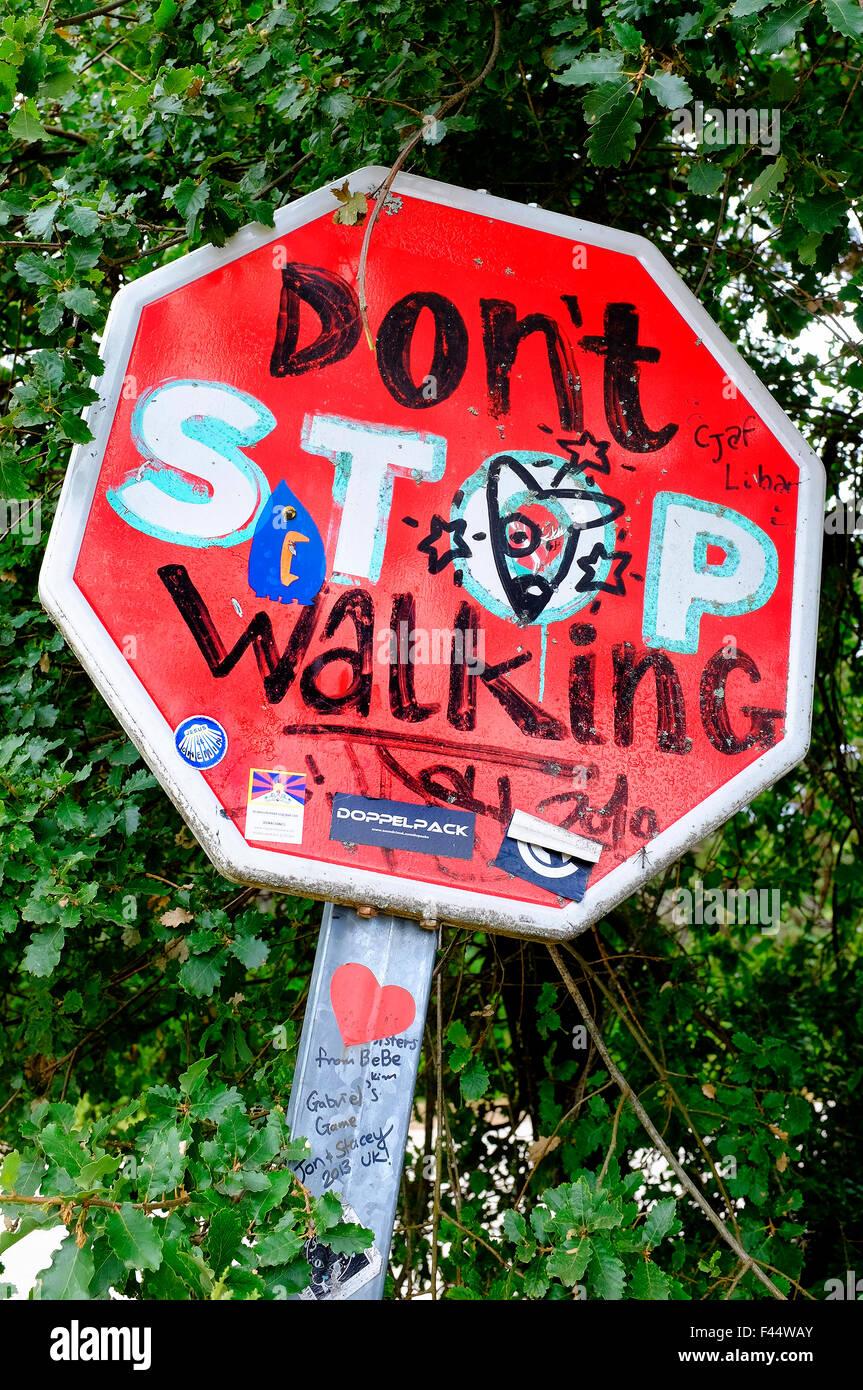 Encouraging road sign (Don't Stop Walking) on the Way of Saint James (Camino de Santiago) - Stock Image