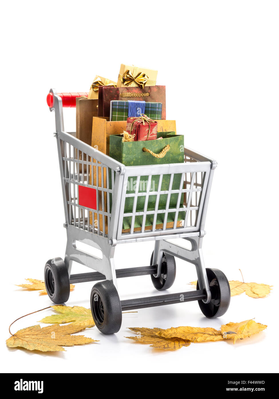 Shopping cart full of bags filled with shopping items with