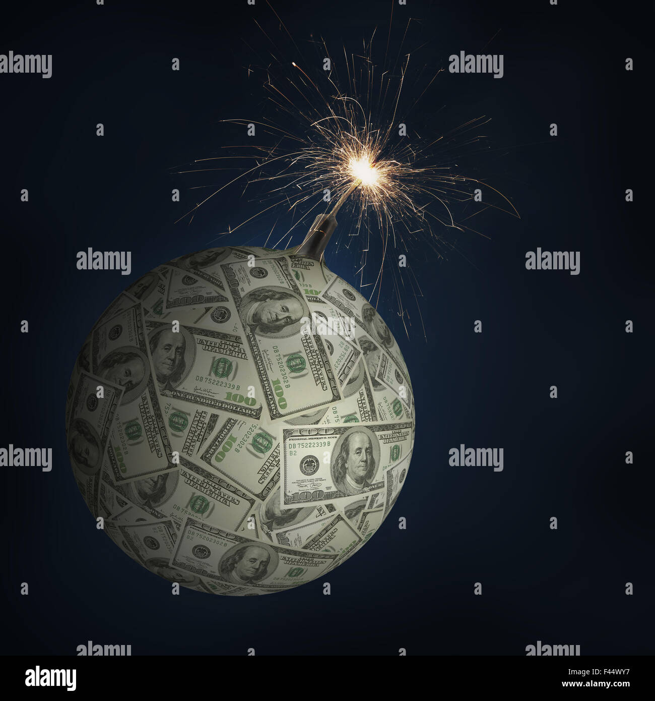 American one hundred dollar sphere as money bomb with burning fuse being a concept of global financial collapse - Stock Image