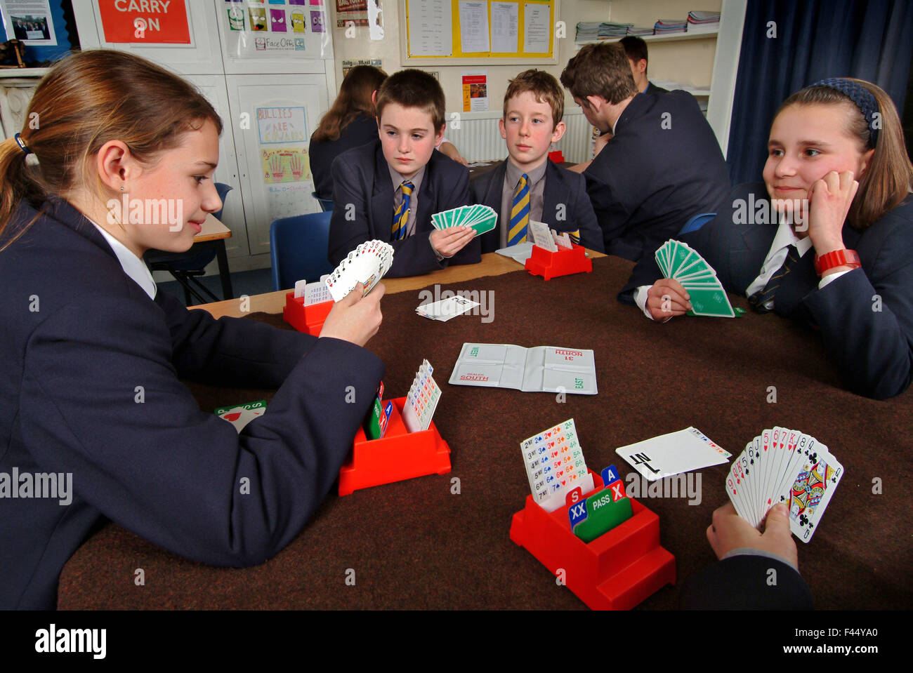Hereford Cathedral School pupils playing the card game bridge in the classroom as part of a mathematics lesson.a UK education Stock Photo