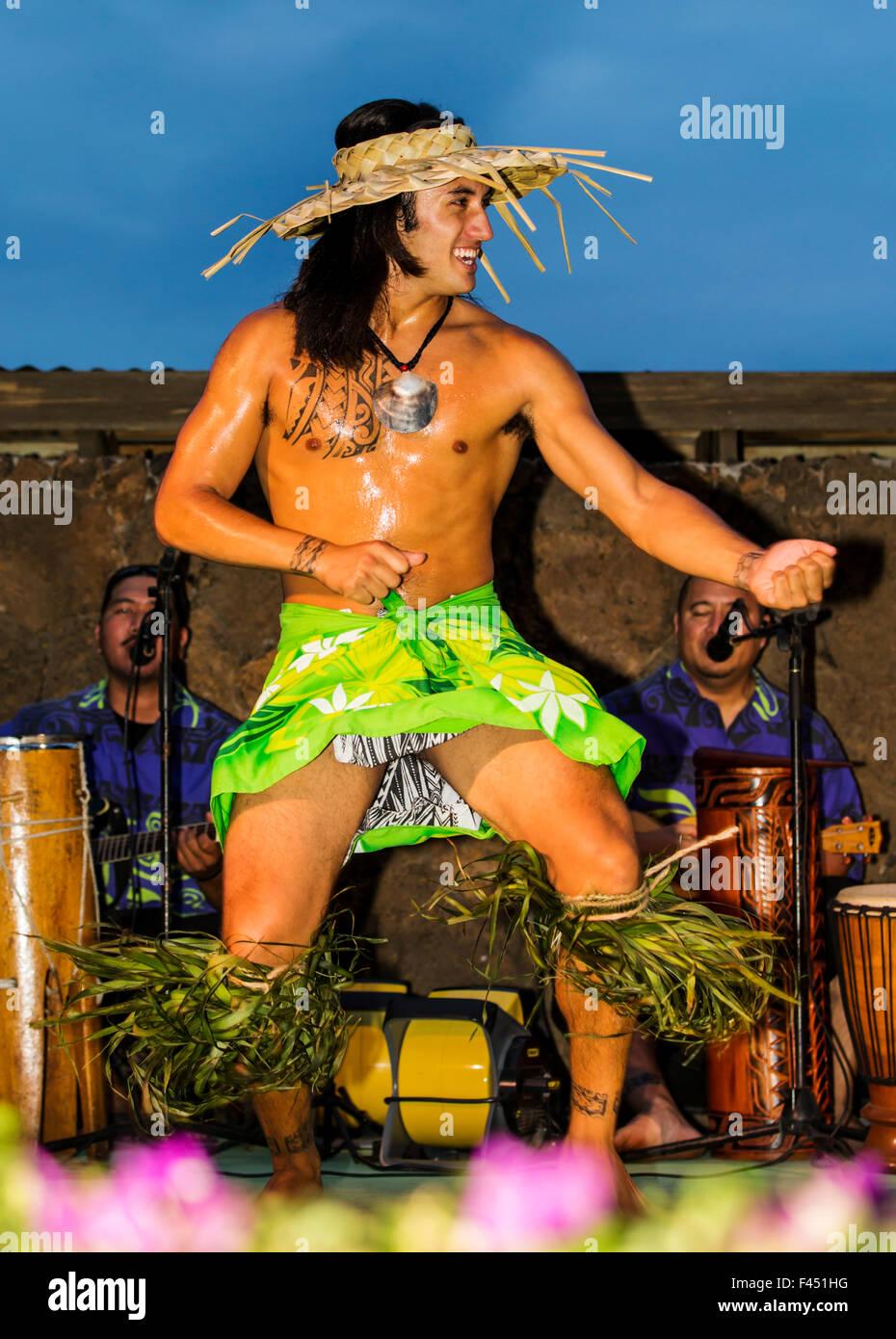 Native male Hawaiian performing traditional dance at Luau, Big Island, Hawai'i, USA Stock Photo