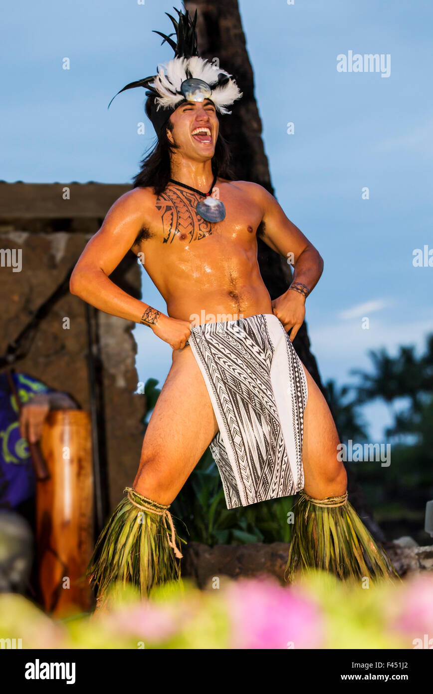 Native male Hawaiian performing traditional dance at Luau, Big Island, Hawai'i, USA - Stock Image
