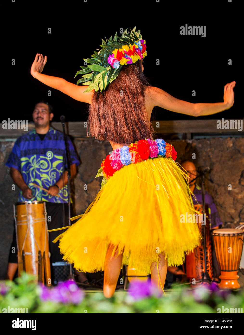 Beautiful young native woman performing traditional dance at Luau, Big Island, Hawai'i, USA - Stock Image