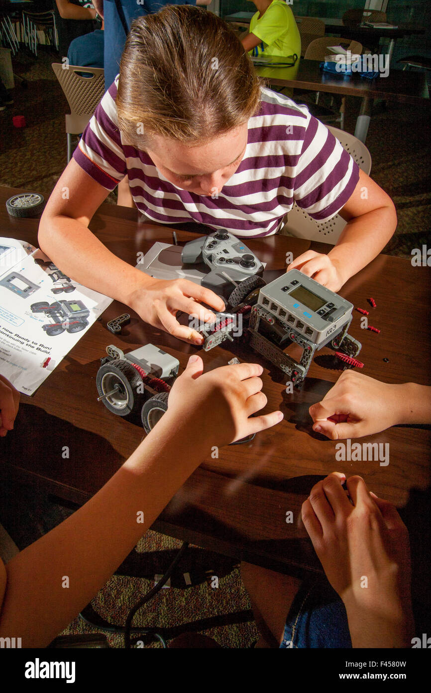 Avid Teen Girls Add Snap On Spare Parts To A Vex Robot Chassis At A